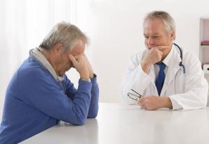 doctor-consultation-w-depressed-man-stock
