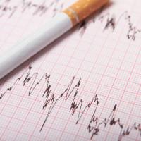 cigarette-on-ecg-printout-stock