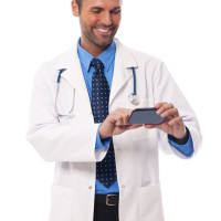 doctor-texting-stock