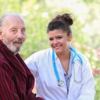 nurse sitting with an elderly patient
