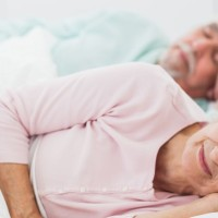 elderly-couple-sleeping-stock
