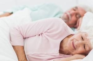 elderly-couple-sleeping-stock