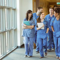 medical residents walking down a hospital hall