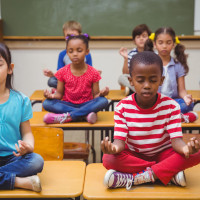 kids-in-school-meditating-stock