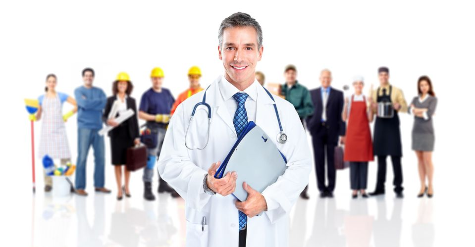 doctor standing in front of community members