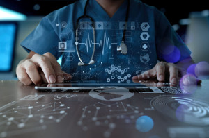 doctor on laptop medical graphics floating in the air