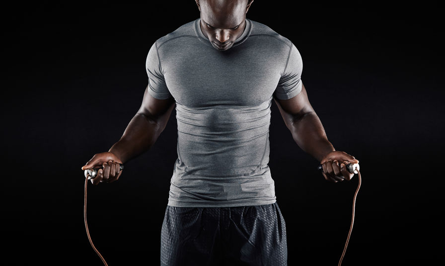 fit afr.amer. man jumping rope