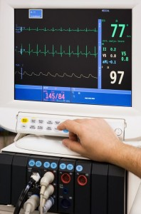 ecg monitor with doctor's hand