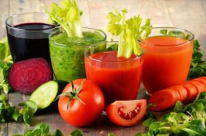 vegetable juices and veggies on a table